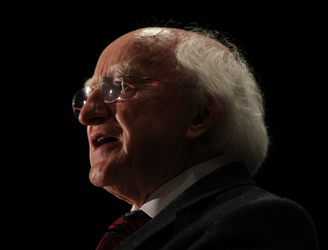 President Higgins congratulates Paul O'Donovan on winning gold