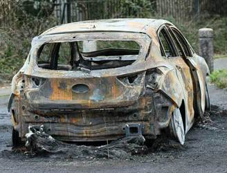 Arrest made over bodies found in burnt-out car in 2012