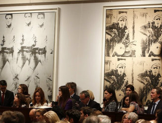 Christie's sells two iconic Warhol paintings for $151.1m
