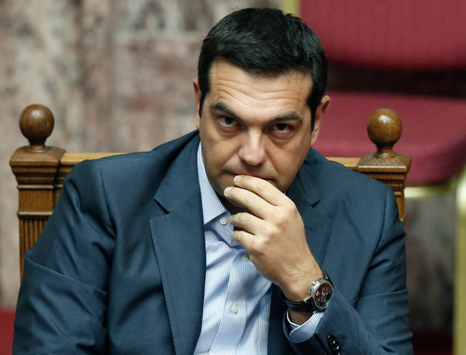 Greece passes more austerity measures to access bailout funds