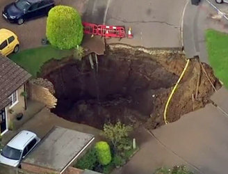 Residents 'trapped' after sinkhole opens in English city of St Albans