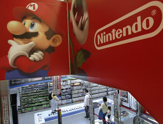 Nintendo share prices drop after company announces its first game for smartphones