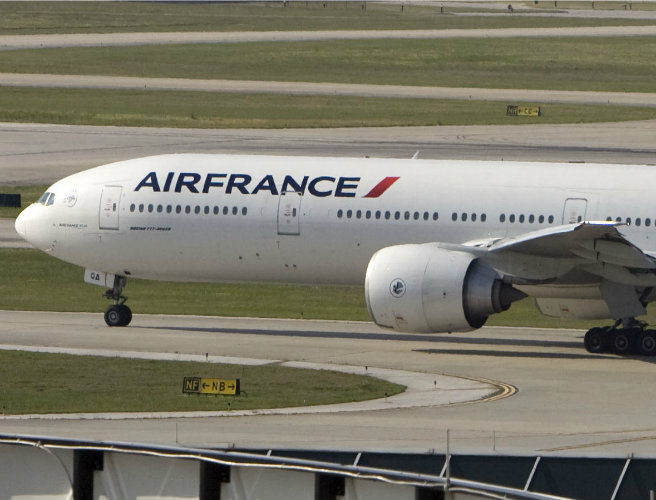 Air France flight attendants fight order to wear headscarves in...