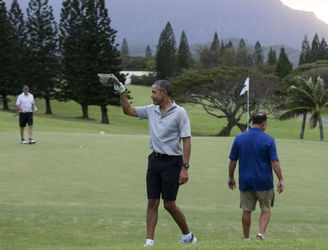 WATCH: President Obama sinks a 40-foot chip on front of the World's media