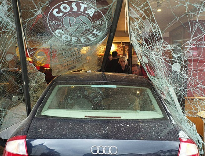 Woman in her 70s has died after car crashes into coffee shop