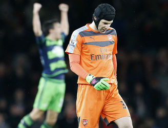 Petr Cech injures himself running up for a late corner against Swansea
