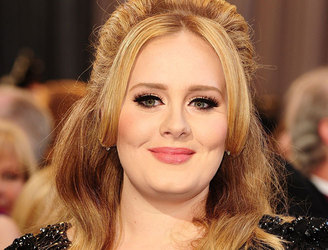 Adele tells Irish fan she will get him a ticket for her Dublin concert