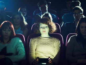"Cinema chain to allow ""texting friendly"" screenings"