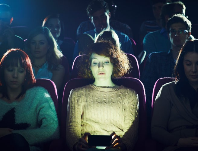 Cinema chain reverses plan to allow people to use their phones during screenings