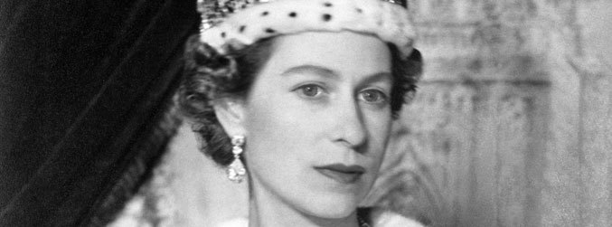A portrait of Queen Elizabeth II in the Imperial State crown in Buckingham Palace, after her coronation at Westminster Abbey | Image: Sport and General / S&G Barratts/EMPICS Archive