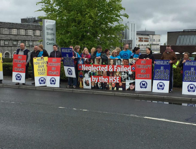 Laois and Offaly families protesting outside HSE offices this morning for better autism services
