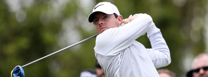 Rory McIlroy keeps pace at the summit while Shane Lowry just about makes the cut