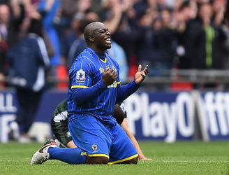 AFC Wimbledon's rapid rise continues as they reach League One ... and derbies with MK Dons