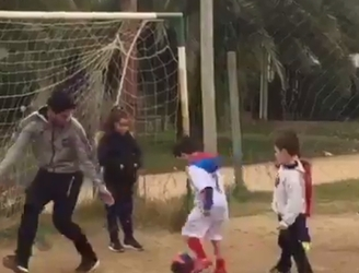 WATCH: Luis Suarez goes back to his roots as he has a kickabout with local kids in Uruguay