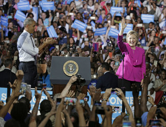 Barack Obama appears on stage with Hillary Clinton at campaign event