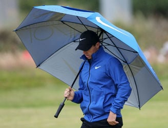 Rory McIlroy battles difficult conditions to remain in the hunt at Royal Troon