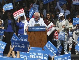 Sanders urges supporters to back Clinton