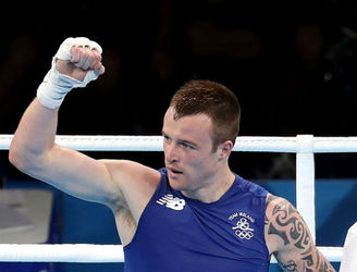 Steven Donnelly fights his way to welterweight quarter-final in Rio