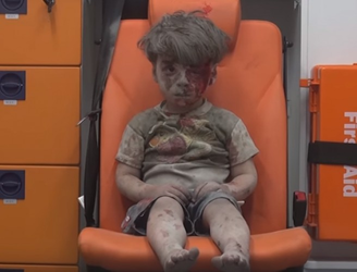 Startling footage shows Syrian boy sitting in ambulance after surviving airstrike