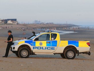 Five men who died at UK beach were trapped by rapidly rising tide
