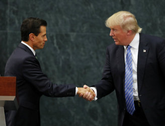 Donald Trump tells Mexican president US 'reserves right' to build border wall