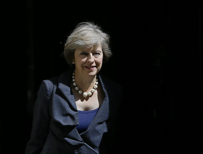 Theresa May moves to allay 'hard Brexit' fears
