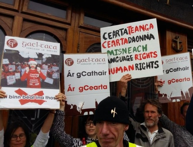 Activists protest outside Cork pub at centre of Irish language row