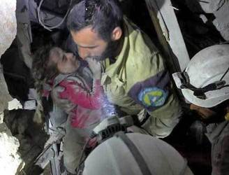 Syrian girl is pulled from Aleppo rubble in four-hour rescue operation
