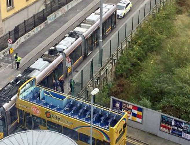 Eight people hospitalised after Luas and tour bus collide in Dublin city