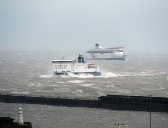 PICS: Crew airlifted from floundering ship as Storm Angus lashes southern England
