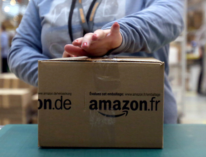 India threatens to deny visas for Amazon workers over doormat spat