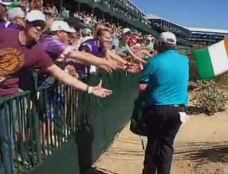 Shane Lowry distributes cans of Guinness at Phoenix Open