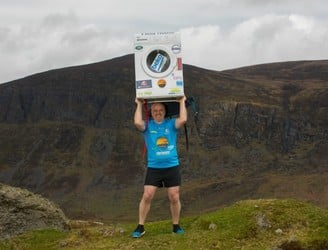 Why is this man climbing Kilimanjaro with a washing machine on his back?