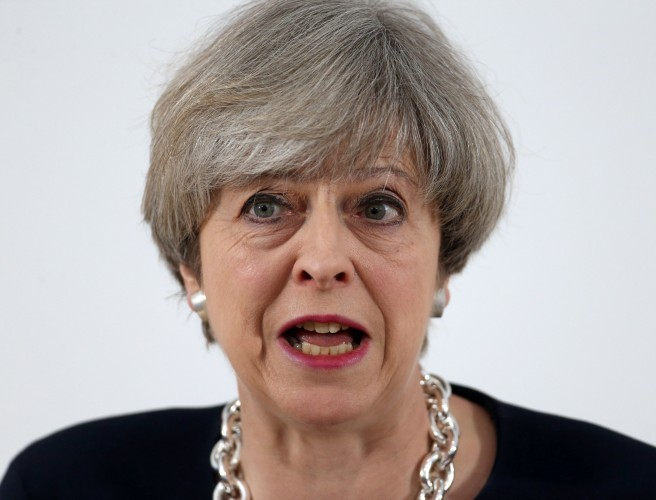 EU warns May might delay Brexit by one year