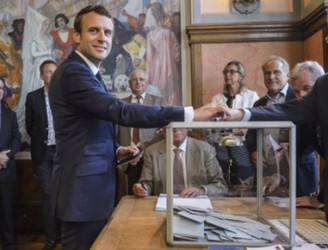 Projections show Macron's party set for parliamentary majority