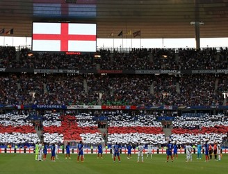 Fans at Stade de France join together for emotional tribute