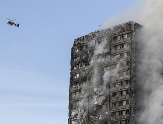 Sniffer dogs used as operation continues at London tower block