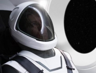 Elon Musk unveils slick new SpaceX spacesuit