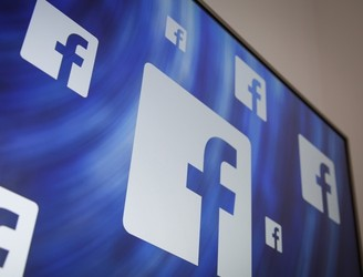 Facebook shares jump as company's ad revenue passes $10bn mark