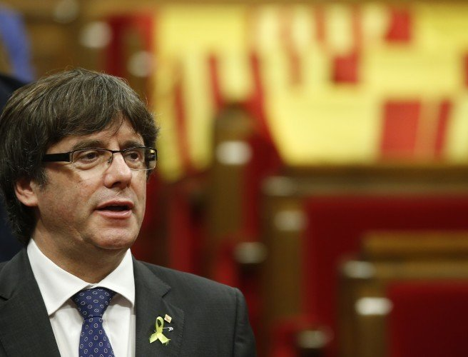 Deposed Catalan president hands himself in to Belgian authorities