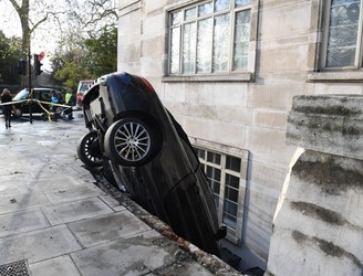Driver arrested after car smashes into apartment basement