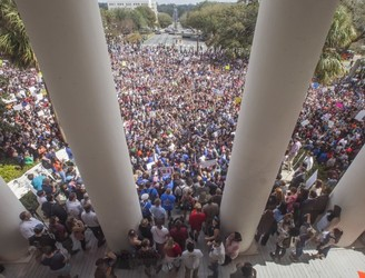 Florida attack survivors join gun control rally in state capital
