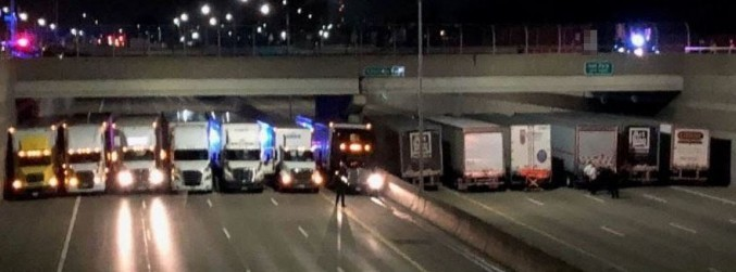 Lorries park under US bridge to help man contemplating taking his own life
