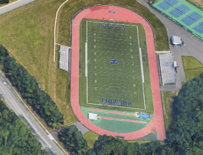Mystery pooper on high school's track field was superintendent, police say