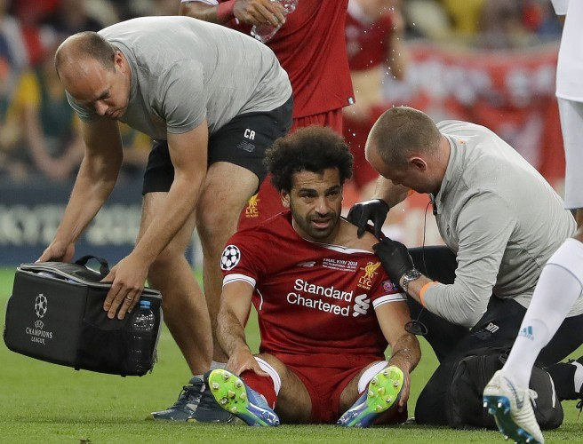 Liverpool's Mohamed Salah gets medical treatment during the Champions League Final. Image: Sergei Grits/AP/Press Association Images
