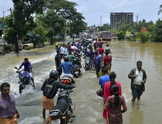 Over 300 dead and thousands homeless as flooding hits India