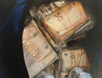 Two men in court over massive cash seizure