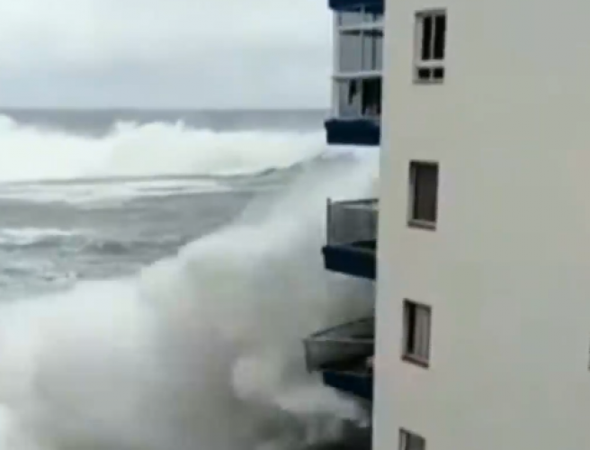 Footage shows enormous waves battering buildings in Tenerife