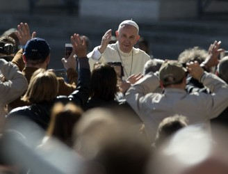 Pope Francis hears the confessions of 16 teenagers at the Vatican after a surprise appearance