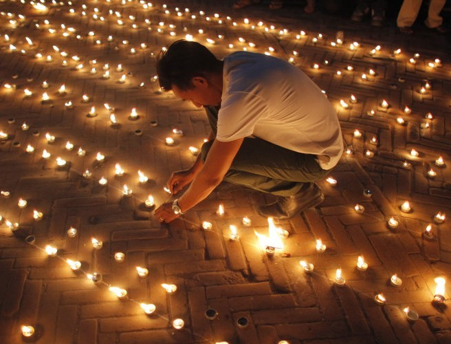 Candle lit memorial held on the first anniversary of the Nepal earthquake which killed almost 9,000 people